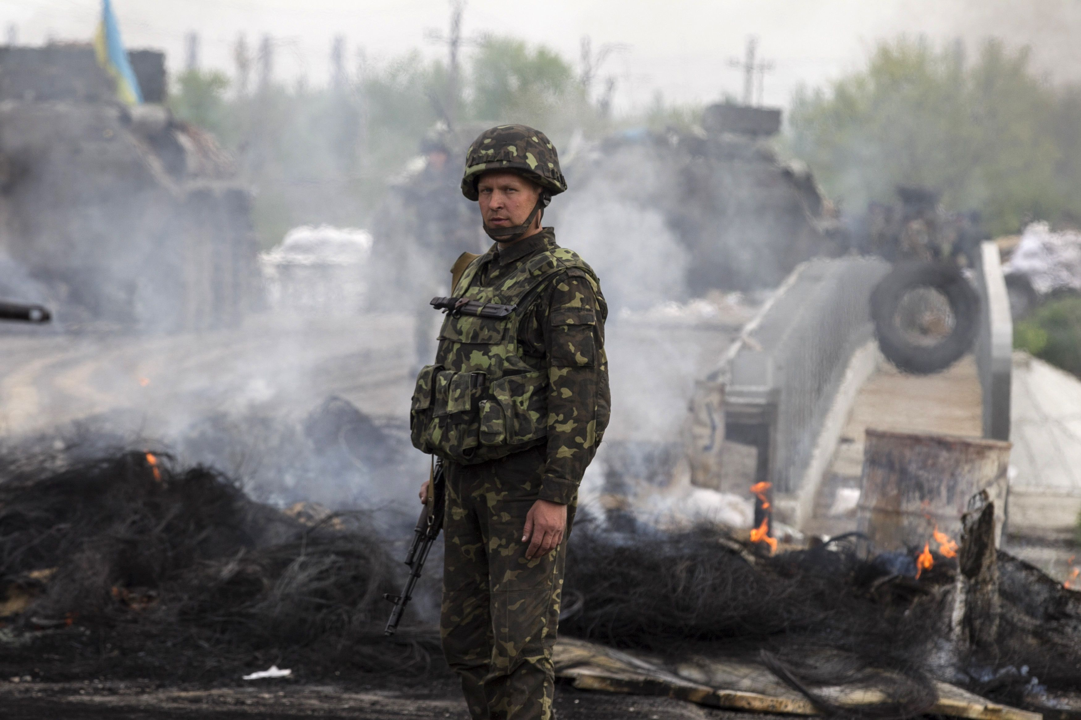 A Ukrainian soldier looks on at a Ukrainian checkpoint near the eastern town of Slaviansk